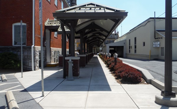 Covered walkway from Appletree Alley lot, looking south