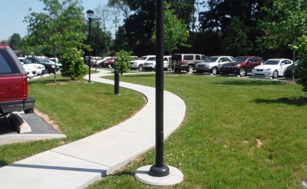 Parking lot, pathway, lighting, and landscaping