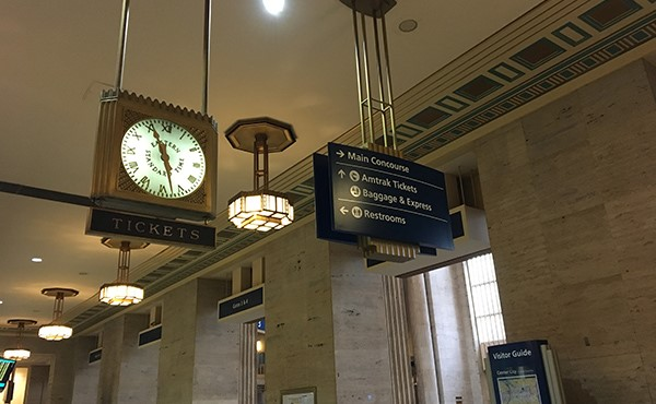 Overhead signs blend with historic fixtures