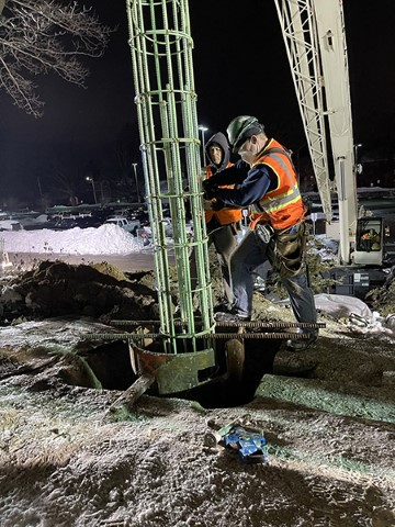 Placing rebar cage for foundation pier (February 2021)
