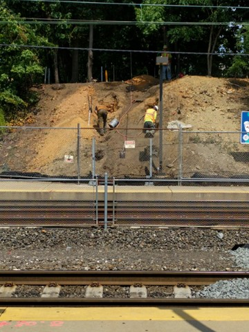 Excavating for temporary stairs to WB platform