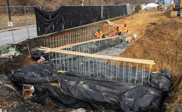 Blankets covering heater hoses to warm area for concrete placement (January 2018)