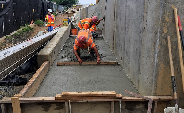 Finishing concrete at westbound ramp/sidewalk (May 2018)