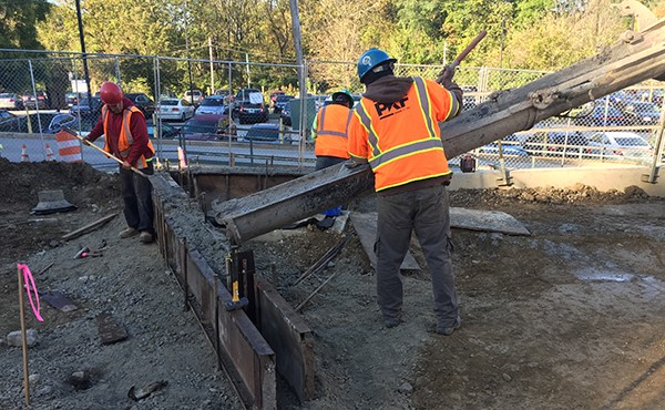 Placing concrete to form curb (October 2017)