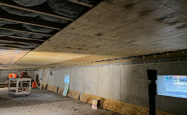 Installing plywood at station building crawl space ceiling (February 2019)