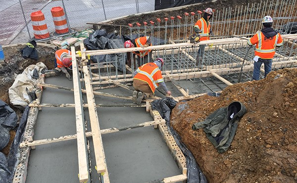 Finishing concrete for ramp/wall footer (February 2018)