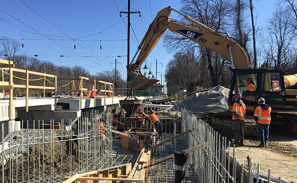 Placing concrete for station building foundation (February 2018)