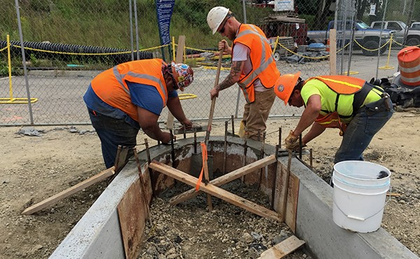 Finishing concrete for curb, eastbound side (September 2018)
