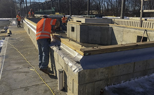 Installing sill plate on station building foundation wall (January 2019)
