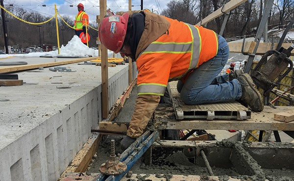 Finishing concrete at station building foundation wall (March 2018)