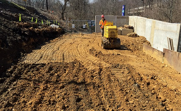 Backfilling and compacting soil at ramp wall (March 2018)