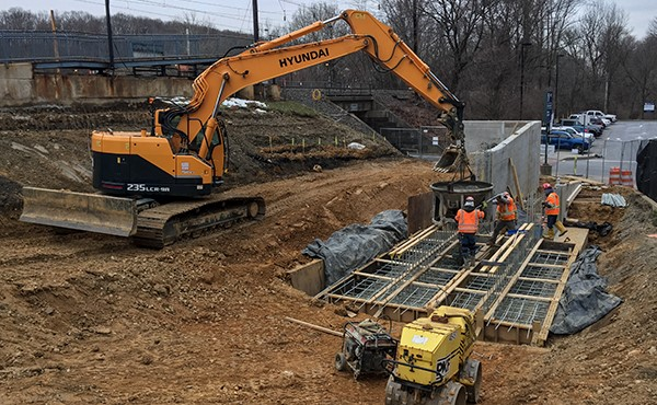 Placing concrete for ramp/wall footer (March 2018)