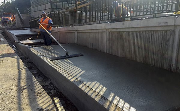 Finishing concrete for westbound sidewalk (October 2018)
