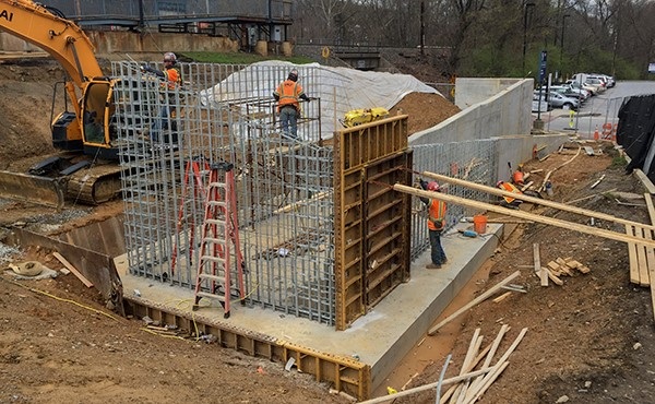 Installing rebar and formwork for ramp wall (April 2018)