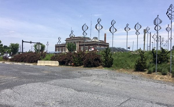 BEFORE: View of station from Christian Street lot (June 2020)