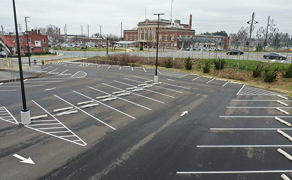 Completed parking lot, looking northwest at station (March 2021)