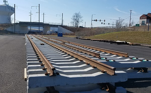 Amtrak track panels staged in parking area (February 2020)