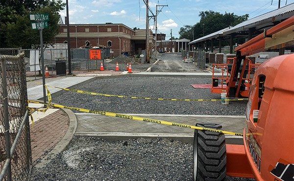E. Henry St. parking lot stamped concrete sidewalk (July 2019)