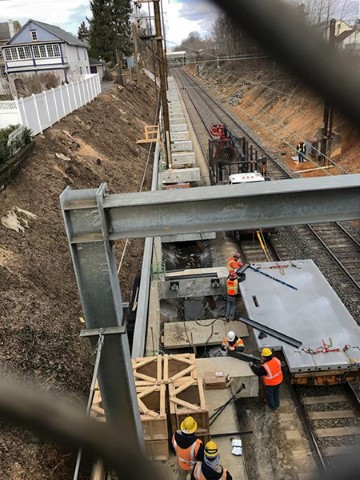 Setting first precast panel for eastbound platform (April 2018)