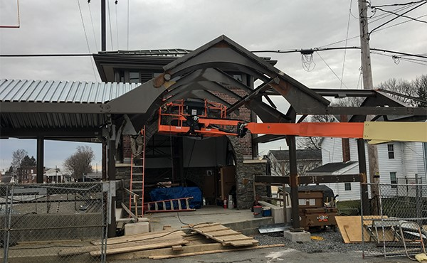 Setting steel for canopy at south tower entrance (March 2019)