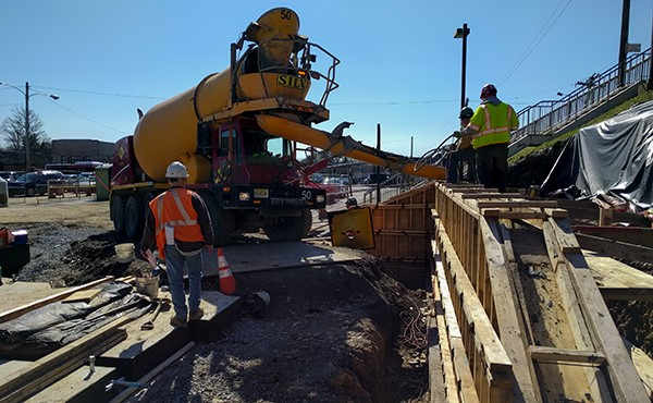 Pouring concrete for south lot retaining wall (February 2018)