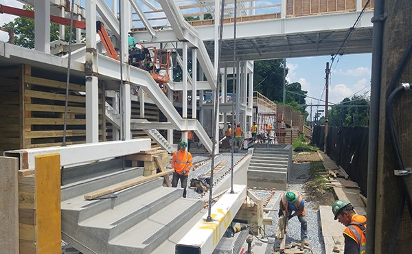 Installing precast concrete stairs at north tower (July 2018)