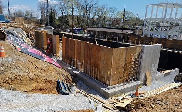 Installing retaining wall formwork at the north lot (April 2018)