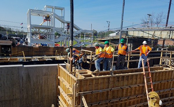 Pouring concrete for north tower retaining wall (May 2018)