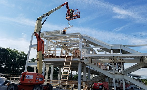 Installing structural steel where pedestrian bridge meets north tower (July 2018)
