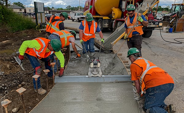 Concrete pour for south lot sidewalk (June 2019)