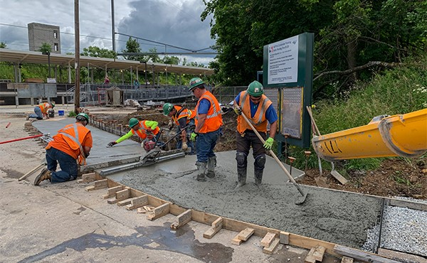 Finishing concrete for south lot sidewalk (June 2019)
