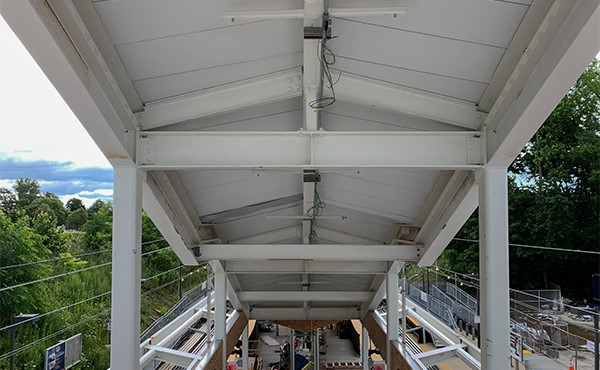 Roof panels installed over center platform stairs (June 2019)