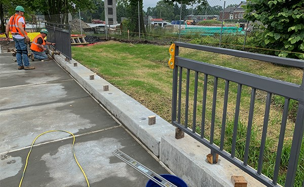Installing fence at east retaining wall of north lot (June 2019)