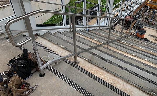 Stainless steel handrail at center platform (July 2019)
