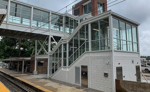 South stairwell, elevator tower, and pedestrian bridge (July 2019)
