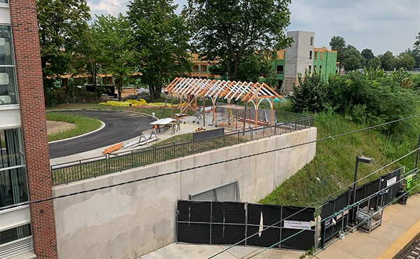 Historic canopy being re-installed as bicycle shelter (August 2019)
