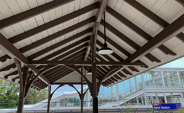 Historic shelter refurbished and repurposed as a bicycle rack canopy (September 2019)