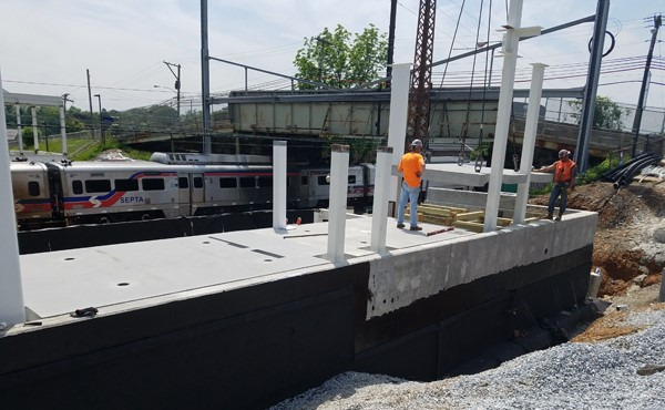 Installing north tower precast floor slabs (May 2018)
