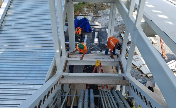 Installing metal risers for north tower stairs (August 2018)