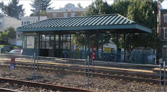 Photo of the current Downingtown Station passenger shelter viewed from trackside. Low-level platform is visible.