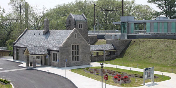 Photo of the front and side of Elizabethtown Station looking southeast. Visible are the refurbished historic station building, elevator tower, platforms and canopies, new sidewalks, and landscaping.